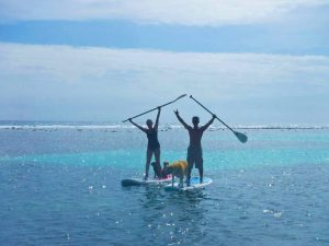 Stand up paddling in front of Hotel Restaurant Maya Luna