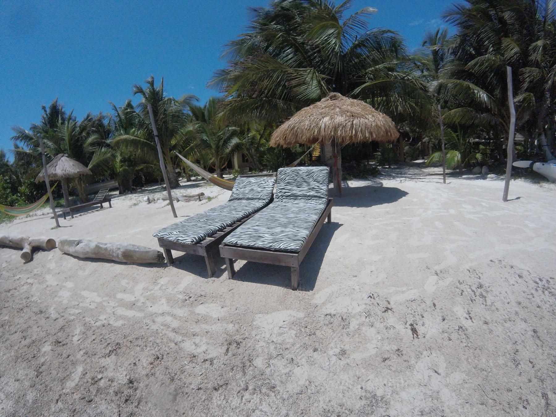 Eco Hotel Restaurant Maya Luna Mahahual. Your beach lounger is waiting for you at Hotel Maya Luna beach. In Mahahual, Costa Maya