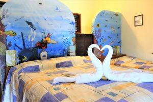 Hotel Maya Luna Mahahual Bungalow Chinchorro bed with murals