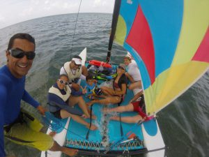 Eco Hotel Restaurant Maya Luna. Dive & Adventure. Sailing with the catamaran in front of hotel maya luna